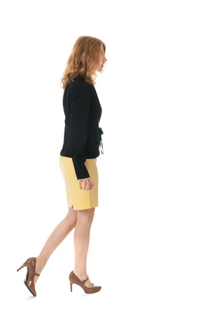 Young elegant business woman is walking by photo