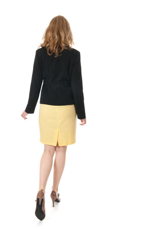 Young business woman is walking away