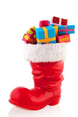 Christmas boot full with presents isolated over white background