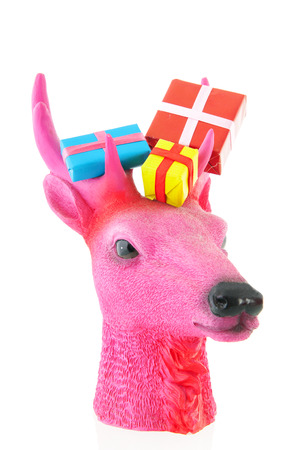 robbon: Pink Christmas reindeer with colorful presents isolated over white background Stock Photo