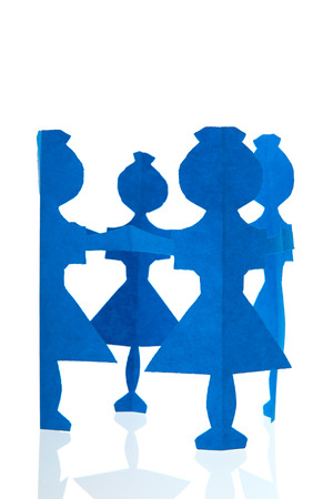 Circle of blue female paper dolls isolated over white background photo