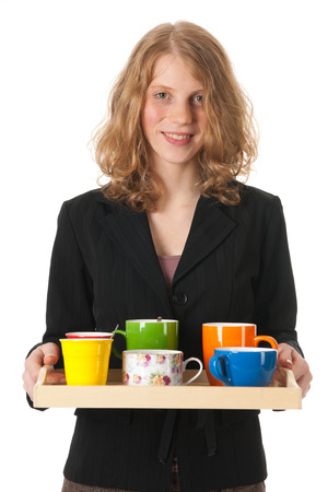 collegial: Young woman at work is bringing coffee for the colleagues