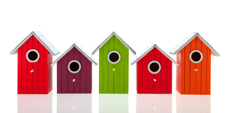 bird house: Colorful bird houses in a row isolated over white background