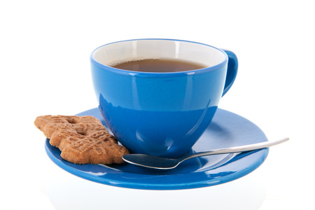 Blue cup of tea with cookie photo