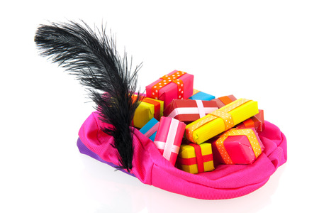 black pete: Pink hat of black Pete with many colorful presents Stock Photo