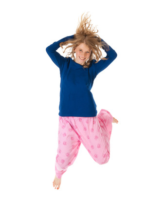 Young woman is jumping in blue and pink pajamas photo