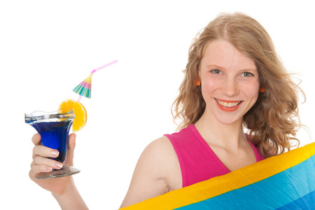 Young woman at the beach with cocktail photo