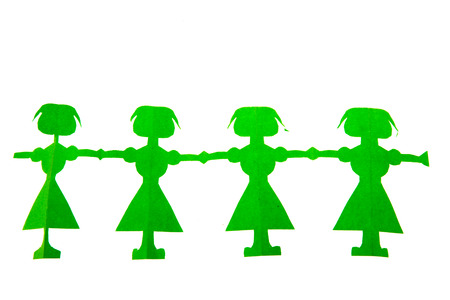 Row of green female paper dolls isolated over white background Stock Photo