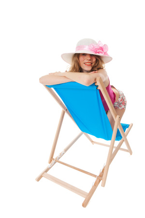 Young blond woman on blue beach chair