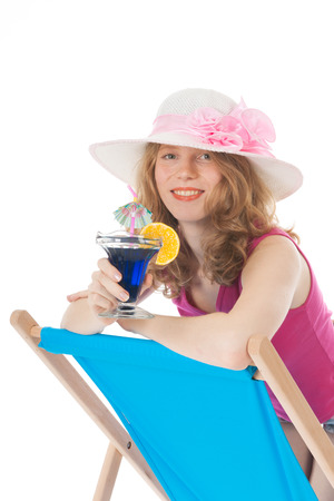 Young woman on blue beach chair with luxury cocktail photo