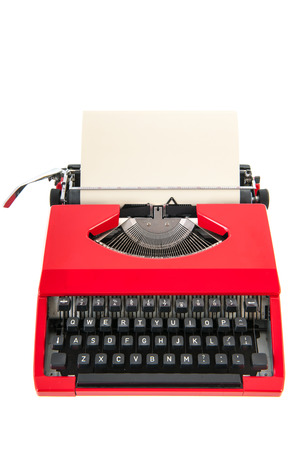 typewriting: Vintage red typewriter with blank paper isolated over white background