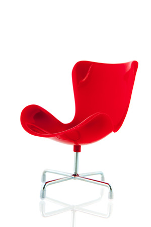 Red chair of the ceo isolated over white background photo