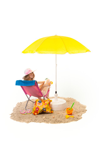 Tranquil beach with pink chair and woman under yellow parasol isolated over white background photo