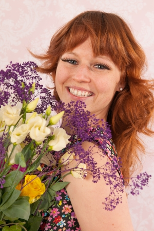 Portrait of woman in interior with colorful bouquet flowers photo