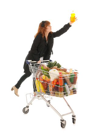 full metal jacket: Woman with shopping cart full with dairy grocery products climbing and picking the soap isolated over white background