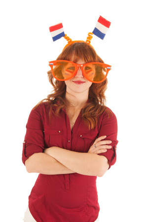 Young red haired woman as Dutch soccer fan
