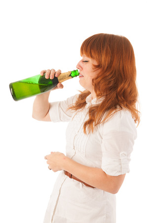Portrait red haired drinking and crying woman photo