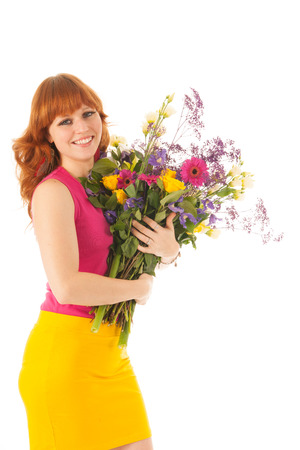 Portrait red haired woman with flowers isolated over white background photo