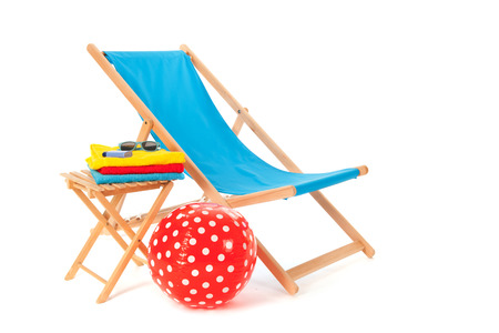 Blue wooden beach chair for vacation isolated over white  photo
