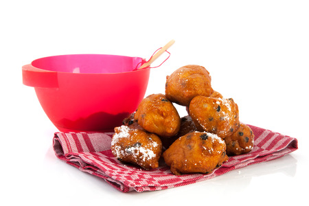 Baking Dutch traditional oliebollen isolated over white
