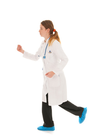 Female doctor with stethoscope running isolated over white  photo