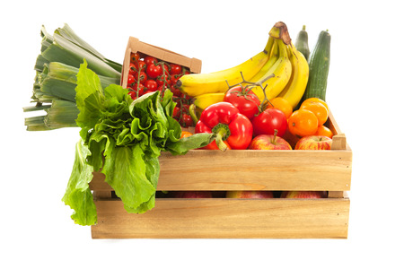 mixed vegetables: Wooden crate fresh vegetables and fruit isolated over white  Stock Photo