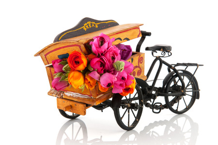 buttercups: colorful bouquet buttercups in pink and orange in wooden vintage transport bike