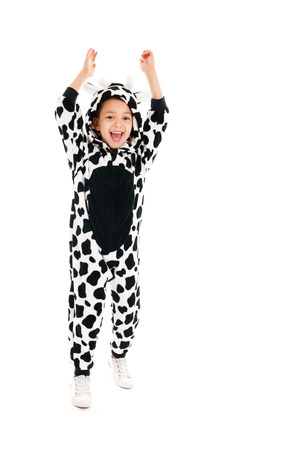 Little boy dressed as cow isolated over white background photo