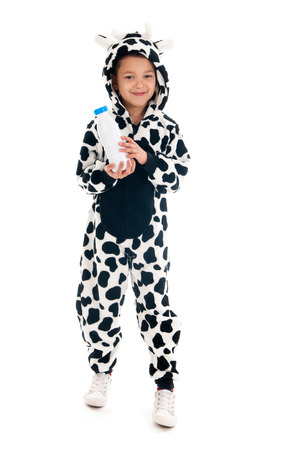 Little boy dressed as cow with bottle of milk photo