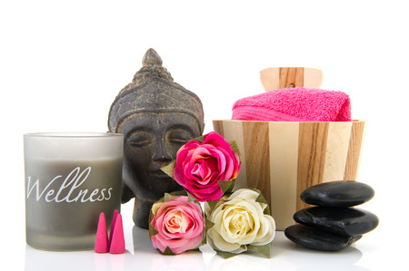 Stilllife with wellness objects as buddha towels and pink roses photo