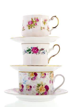 stacked vintage coffee or tea cups isolated over white background Stockfoto