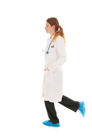 Female doctor with stethoscope running isolated over white background photo