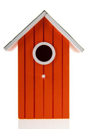 bird house: Orange bird house isolated over white background