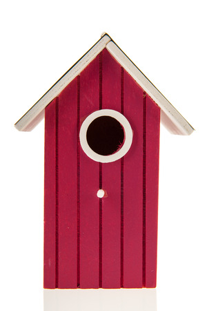 Purple bird house isolated over white background photo