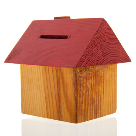 wooden house as piggy bank photo
