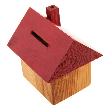 wooden house as piggy bank photo