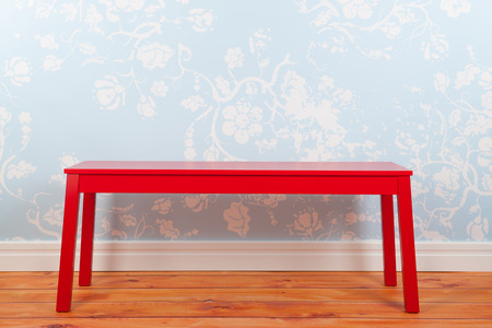 Room with blue vintage wall paper red bench on and wooden floor photo