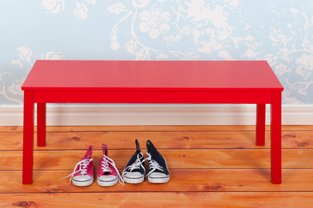 Hall with blue vintage wall paper red bench on and wooden floor and shoes  photo