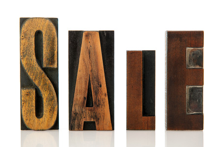 selling off: sale in vintage wooden print letters
