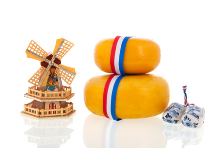Two whole dutch cheeses with ribbon in flag colors isolated over white background photo