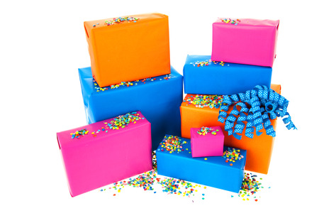 Pile gifts in many colors with confetti isolated over white background photo