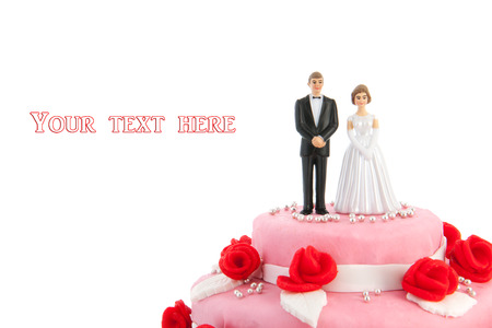 wedding food: Pink wedding cake with red roses isolated over white background