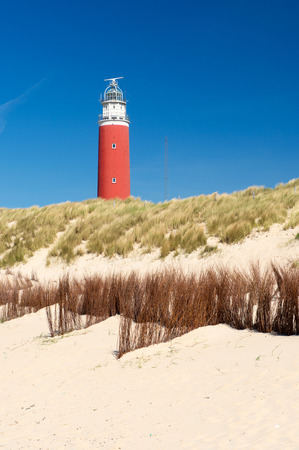 REd lighthouse at Dutch wadden island Texel photo