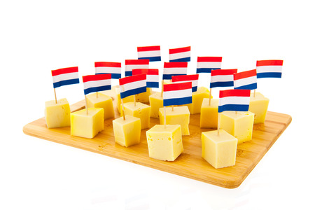 butterfat: Dutch cheese cubes with flags isolated over white background