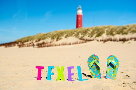 wadden: Texel Dutch wadden island with lighthouse and flip flops