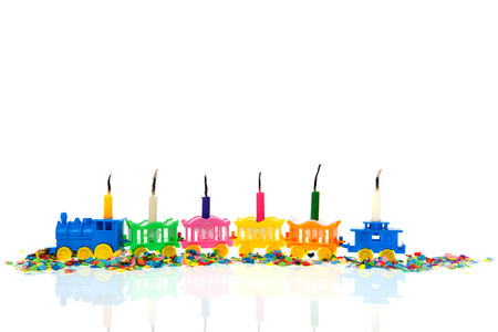 birthday train: Birthday train with burned candles isolated over white background Stock Photo