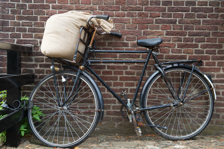miller: Bicycle from the miller with jute bag flour Stock Photo