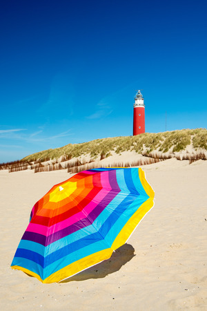 Colorful parasol at the summer beach photo