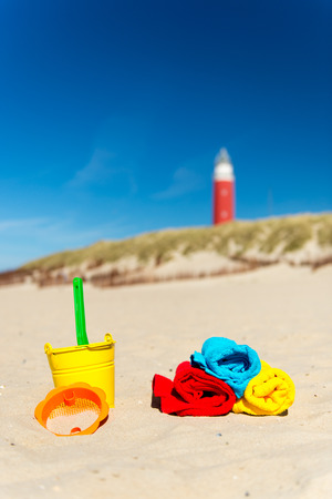 Texel Dutch wadden island with lighthouse and toys photo