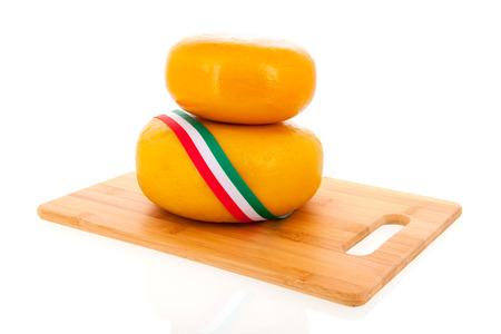 Two stacked whole Italian cheeses isolated over white background photo